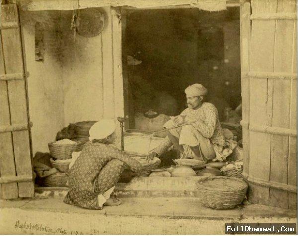 Man Selling Various Daily Need Products At A Shop In Chandni Chowk - Delhi Circa 1862